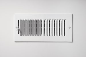 heating-cooling-vent-register-on-the-wall-of-a-home