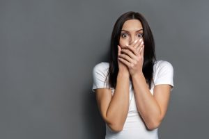 scared-woman-covering-mouth