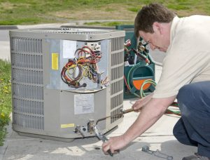 air-conditioning-technician-working-on-system