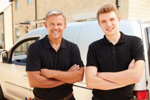 two-hvac-techs-standing-with-arms-crossed