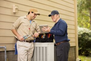 two-technicians-working-on-air-conditioner